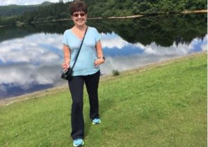 beneficiary Helen Shore taking a walk to keep active
