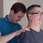 physiotherapist Fraser treating David in his upper back to reduce his pain