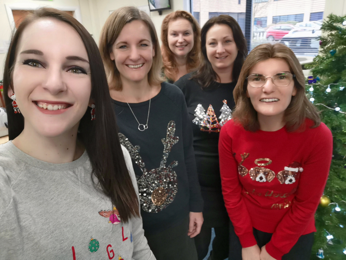 Admin team in christmas jumpers