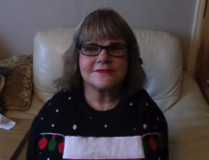 Mandy wearing OrCam glasses