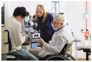 scientist in wheelchair working in laboratory