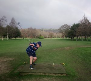 Neal Merry playing golf