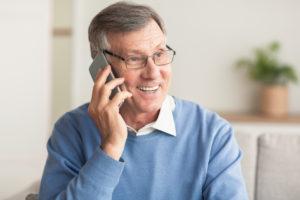 male volunteer talking on phone