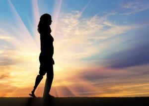 Woman walking with a prosthetic leg