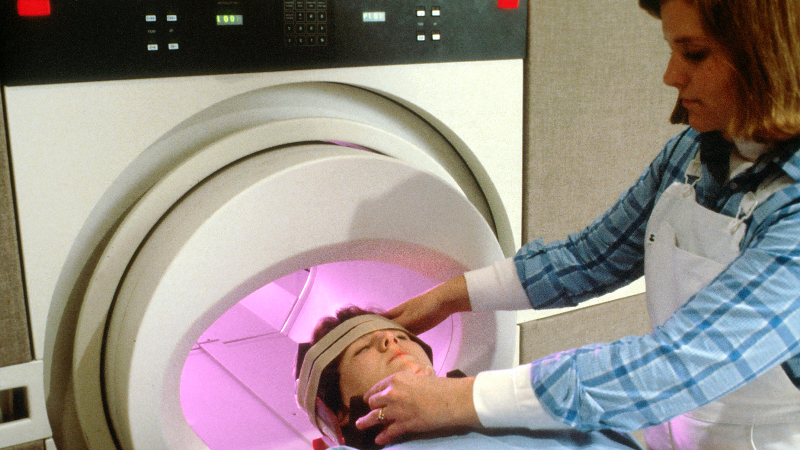 woman being prepared for a body scan in hospital