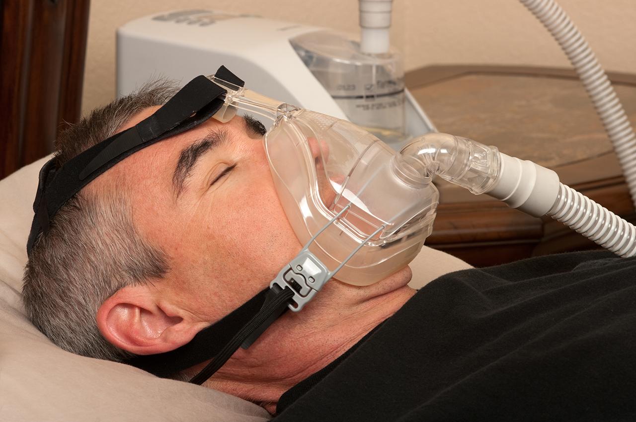 man wearing CPAP mask to combat sleep apnoea